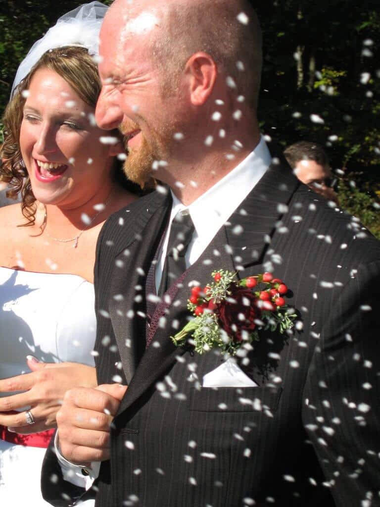 Eco-friendly bride and groom celebrate their environment with non toxic confetti.