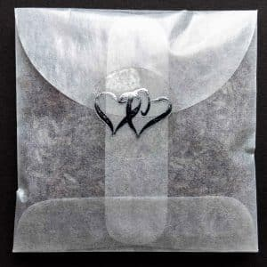 Let us make envelopes of non-toxic confetti for you, sealed with Silver Double Hearts