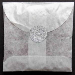 Let us make envelopes of non-toxic confetti for you, sealed with Silver Glitter