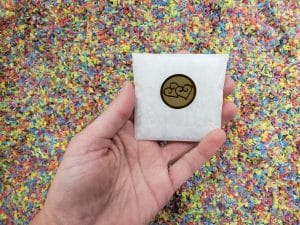 Have us make a small envelope of water soluble wedding confetti for you.